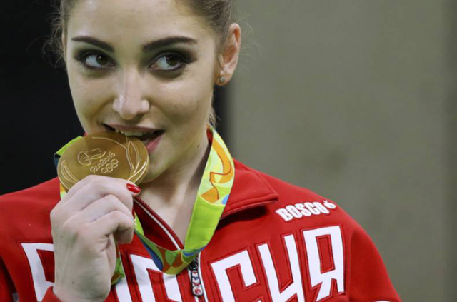 Did You Know Why Winners Bite Their Oylmpic Medals In Photos